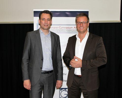 Georg Eisenreich und Michael Haberland lächeln in die Kamera
